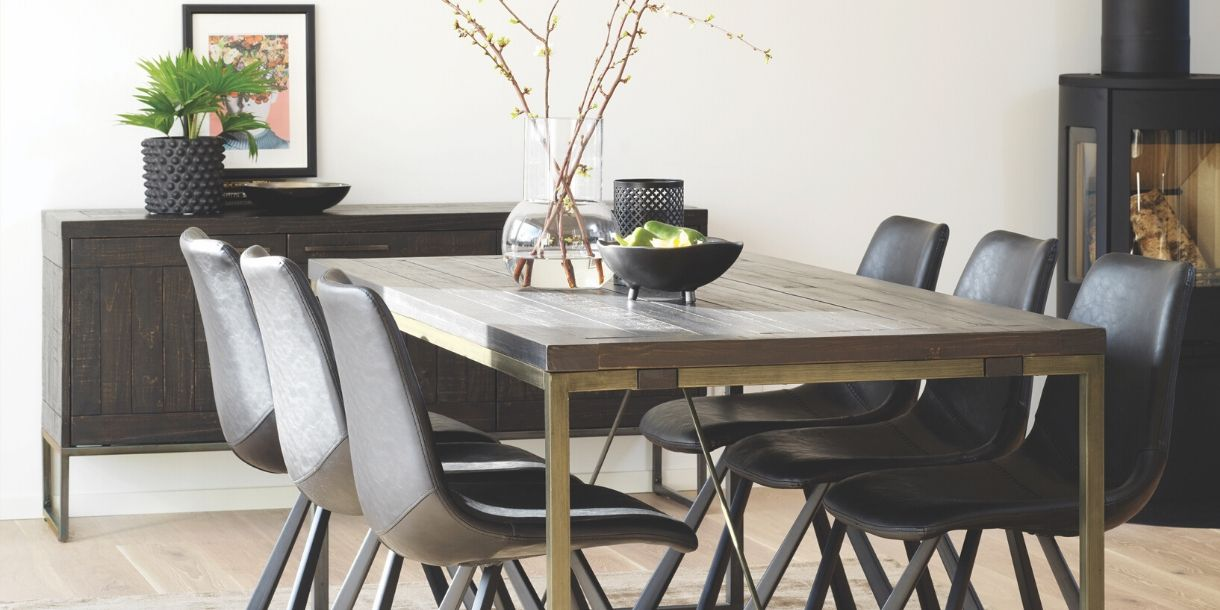 Large rustic and industrial dining room table in the tavistock range in a dining room