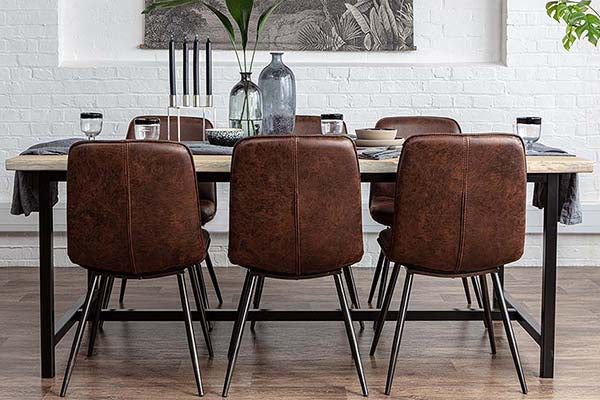 Industrial style oak dining table on steel legs with industrial dining chairs
