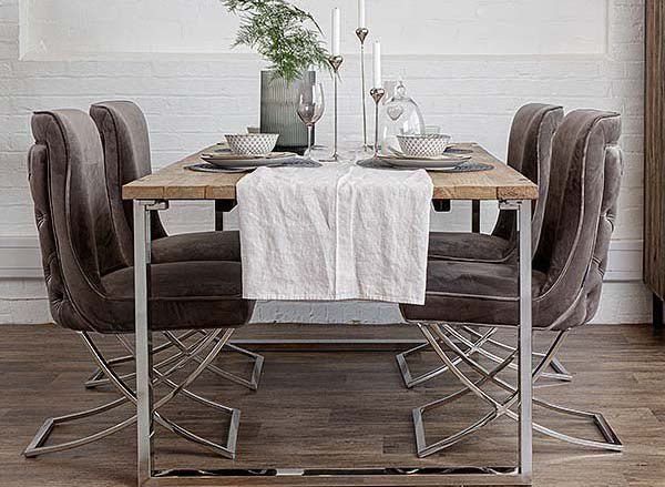Luxurious reclaimed elm dining table with taupe velvet dining chairs