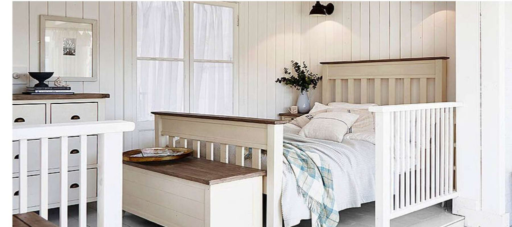 White reclaimed wood bedroom furniture, including bed and wood blanket box