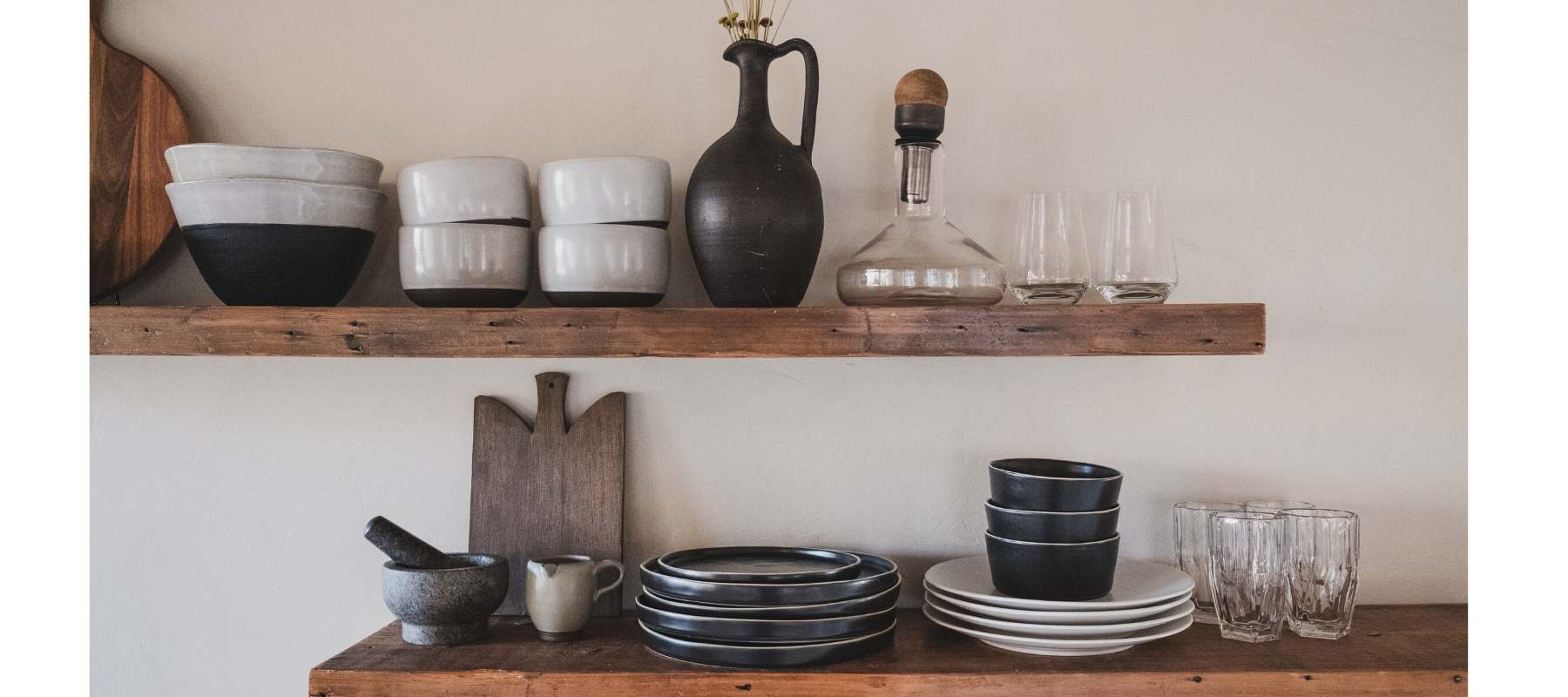 Rustic wooden kitchen shelves with pots and vases