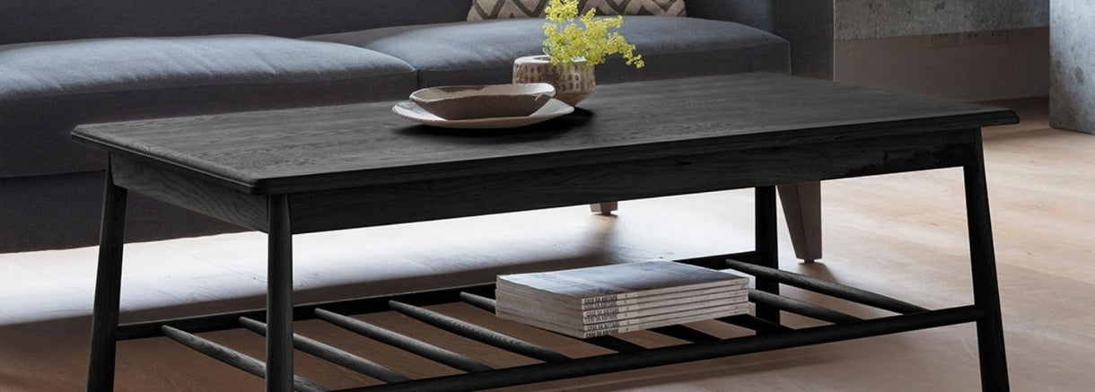Wycombe Black Oak Rectangle Coffee Table with magazines