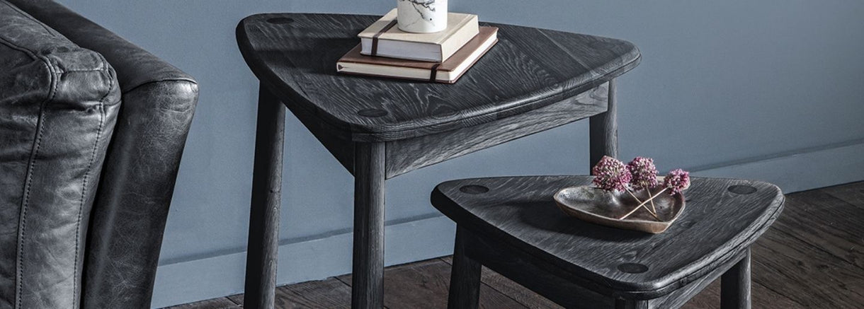The Hudson Living Wycombe Black Oak Nest of Tables with flowers and books on them