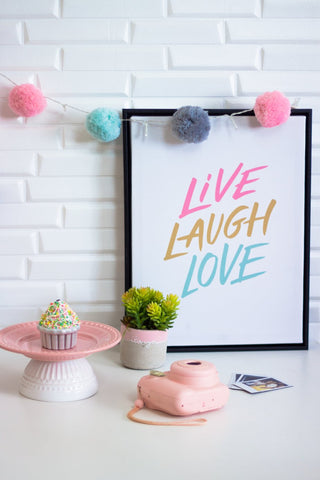 Live, laugh, love print with pom pom garland