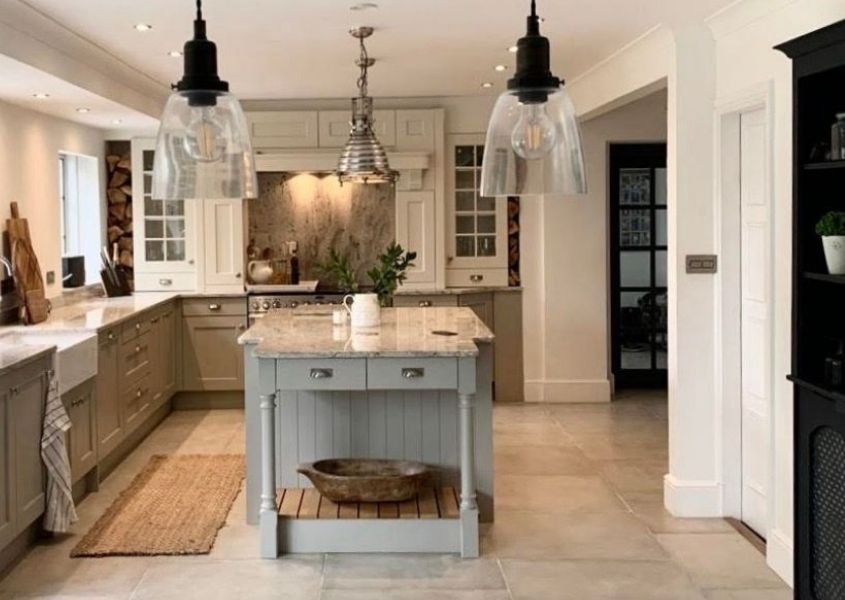 Pale grey shaker kitchen with kitchen island and glass hanging pendant lights