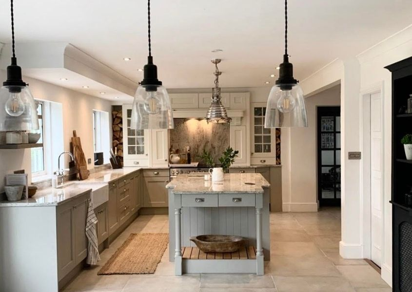 Modern country style grey kitchen with island and glass hanging pendant lights