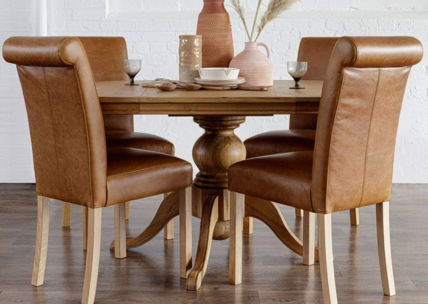 round dining table with brown leather dining chairs