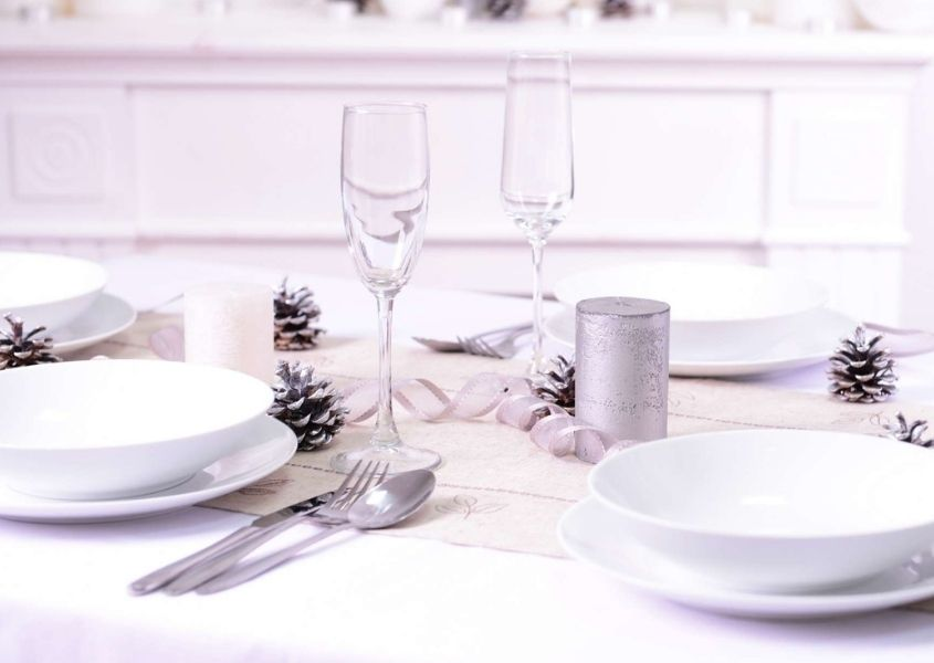 bright white christmas dining table with white plates