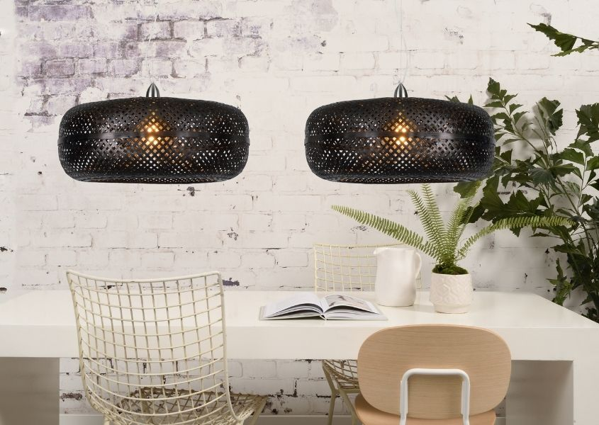 Black Bamboo double pendant ceiling light above white dining table