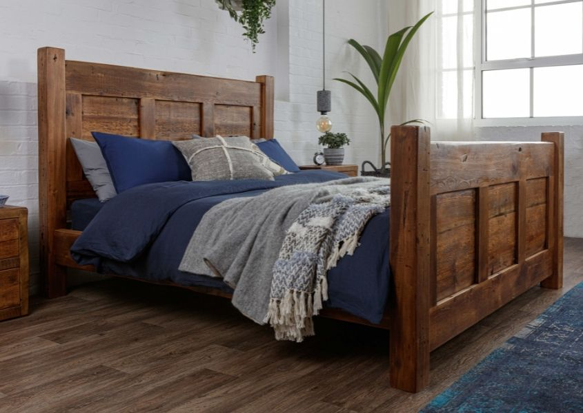 King size wooden bed frame with wooden headboard and footboard