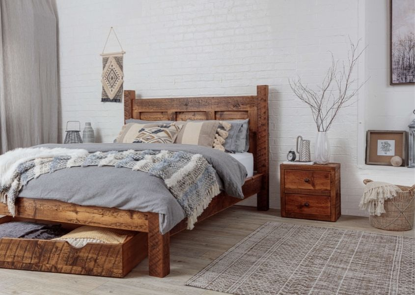 reclaimed wood bed frame with grey covers, matching under bed drawer and small bedside table
