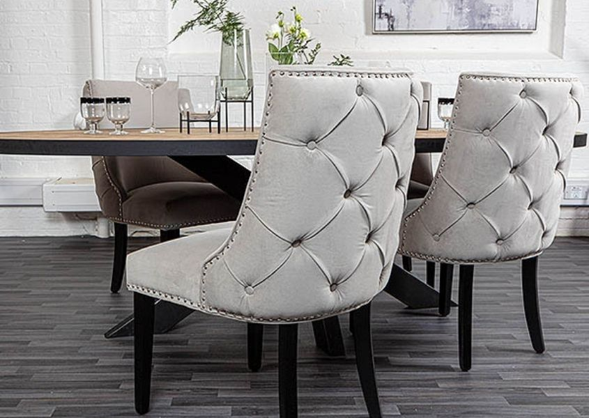 Back buttoned grey velvet armchairs with black wooden legs