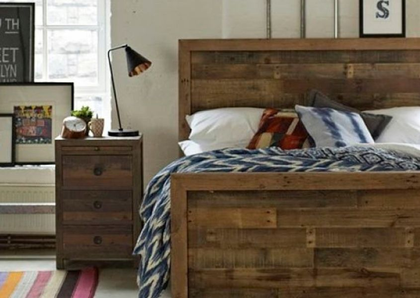 Reclaimed wood bed and matching side table with white and blue bed covers