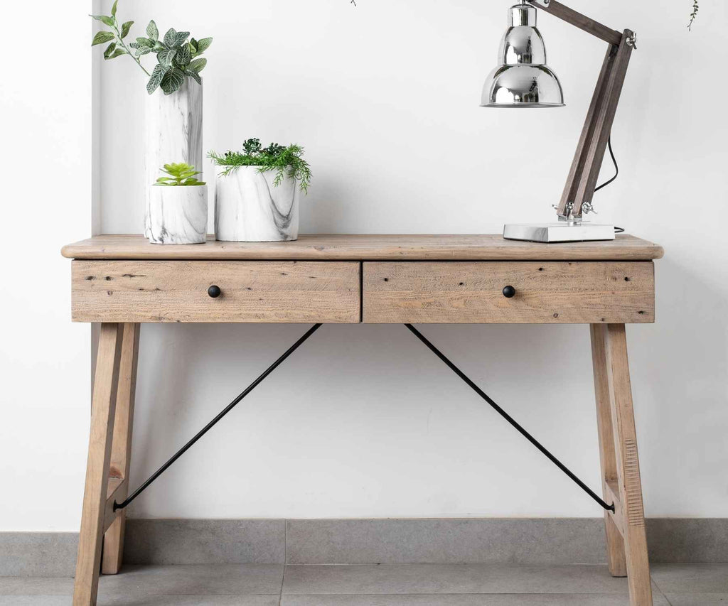 Reclaimed wood console table with lamp and plants