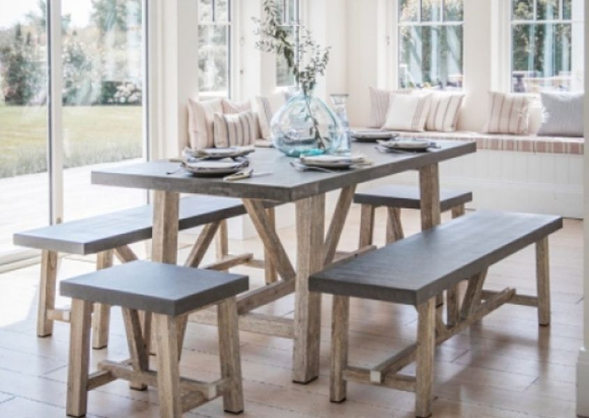 Wooden dining table in pale wood with matching dining bench and stool