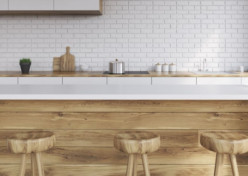 Wooden kitchen island with three wooden bar stools