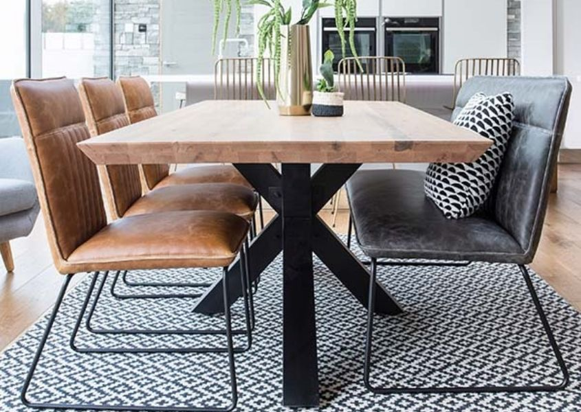 Spider leg dining table with grey faux leather dining bench with back