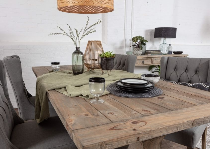 Reclaimed wood dining table and grey fabric dining chairs