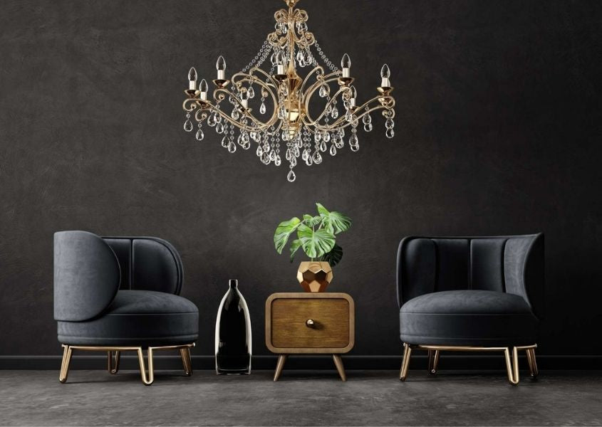 dark living room with grey fabric armchairs and wooden side table