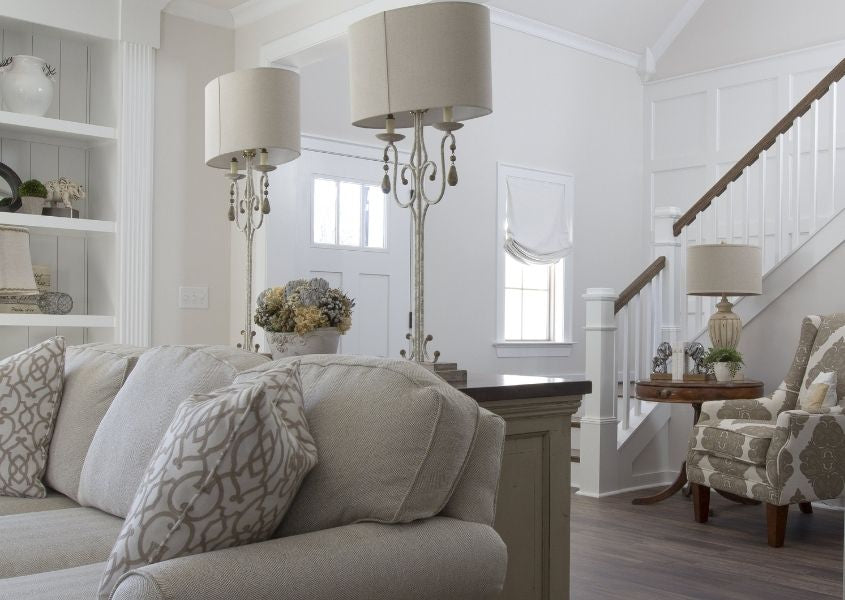 white living room with white sofa and table lamp