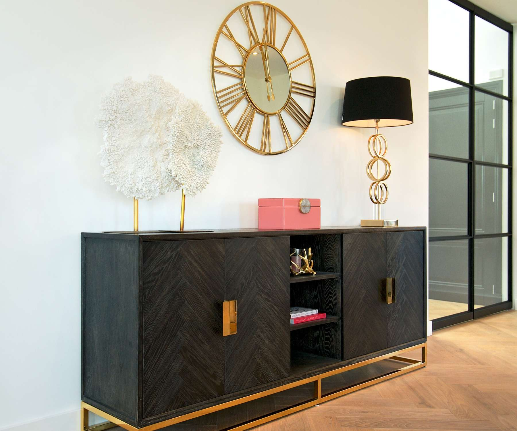 dark wood industrial sideboard with gold accessories