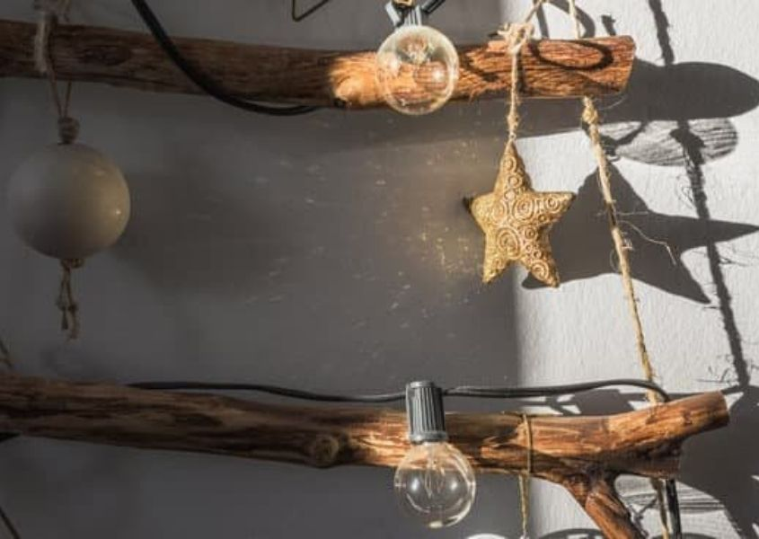 Close up of Christmas tree made from tree branches, wooden stars and string