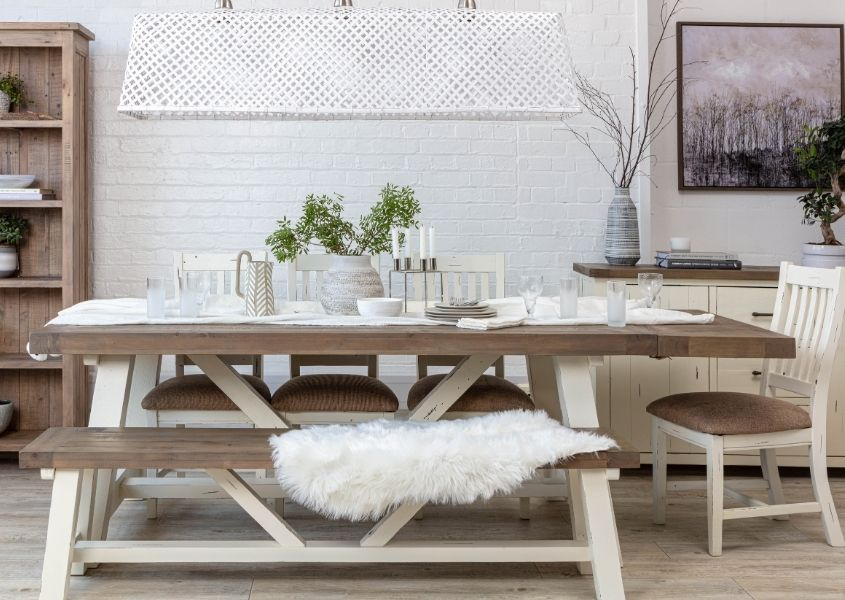 Reclaimed wood extendable dining table with white trestle legs and matching wooden bench