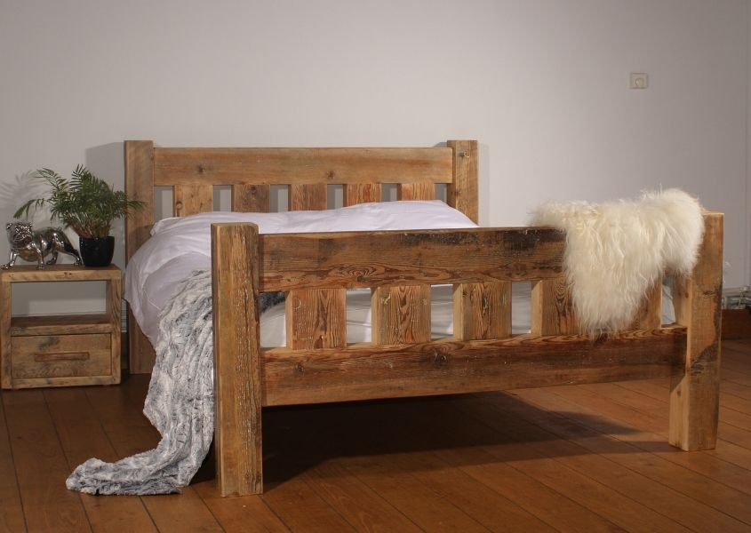 Reclaimed wood bed with bedside table