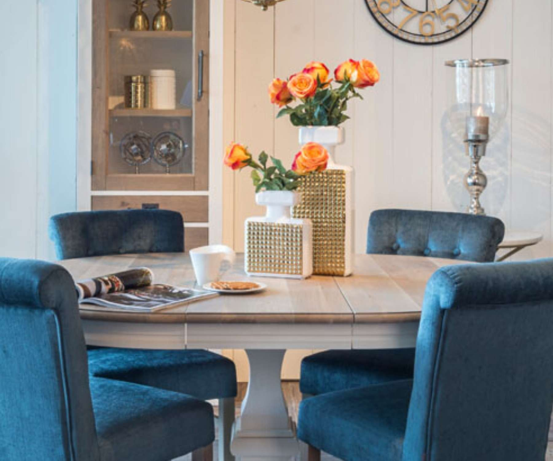 extended round dining table with blue velvet chairs