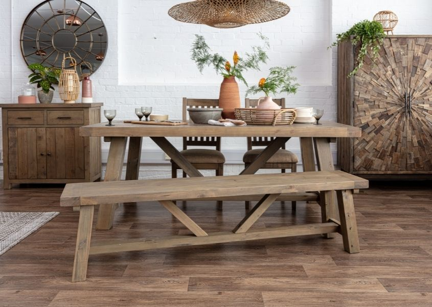 Reclaimed wood dining table with trestle legs and matching wooden bench