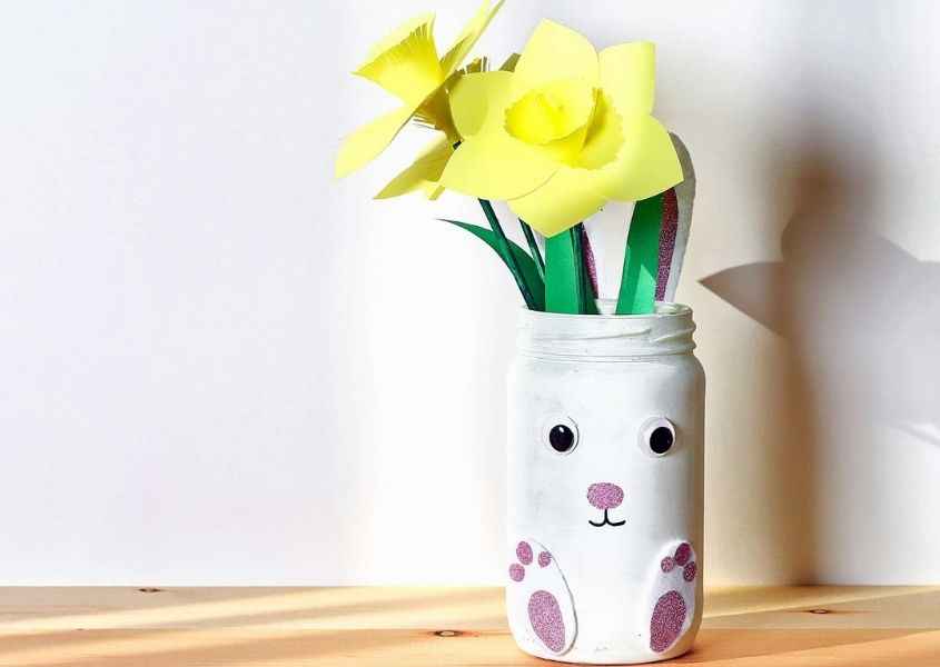 Paper daffodils in a white bunny rabbit vase