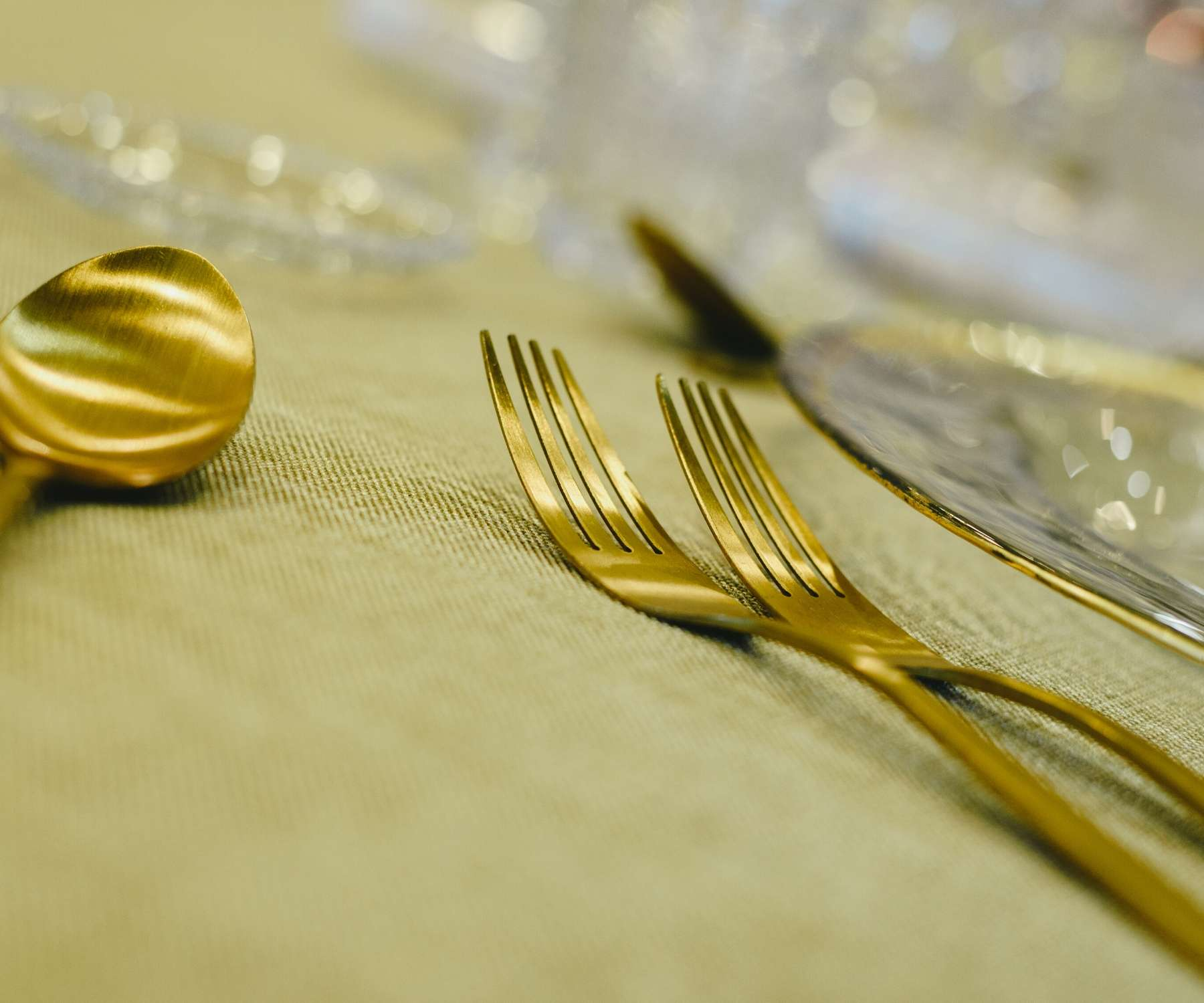 gold cutlery on gold tablecloth