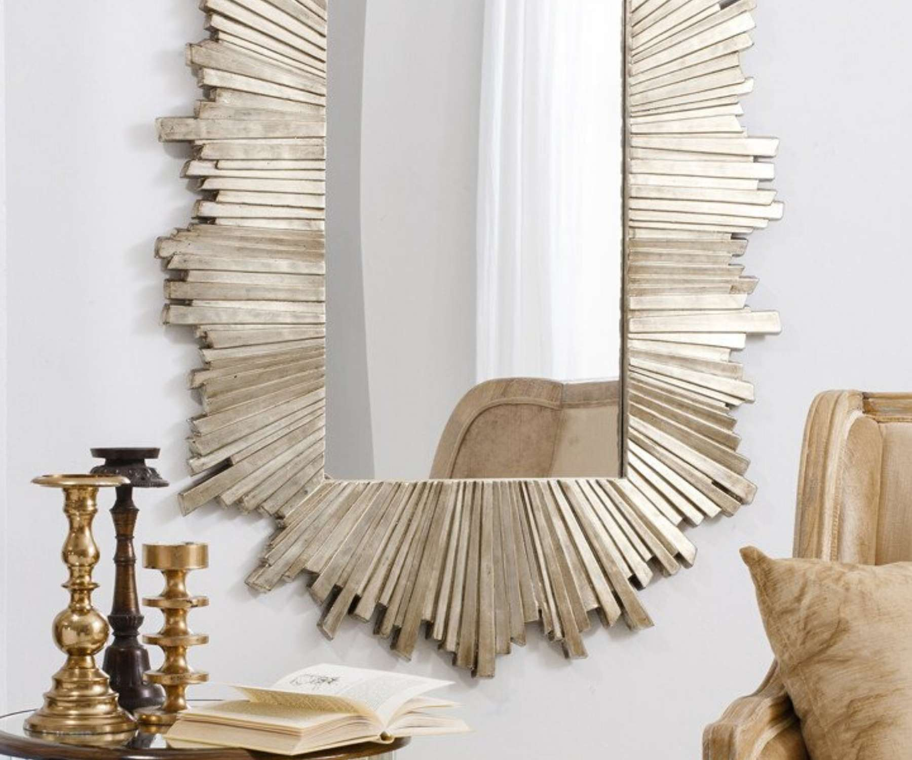 gold wall mirror and candle sticks