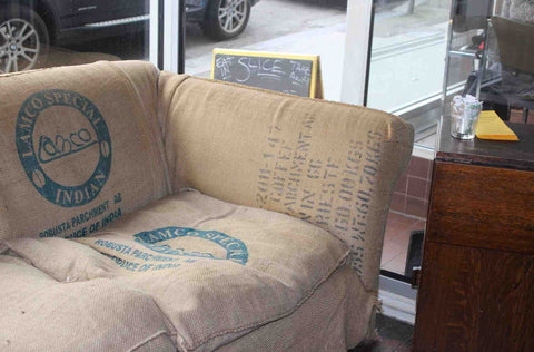 old grain sack used to upholster sofa in cafe in hove