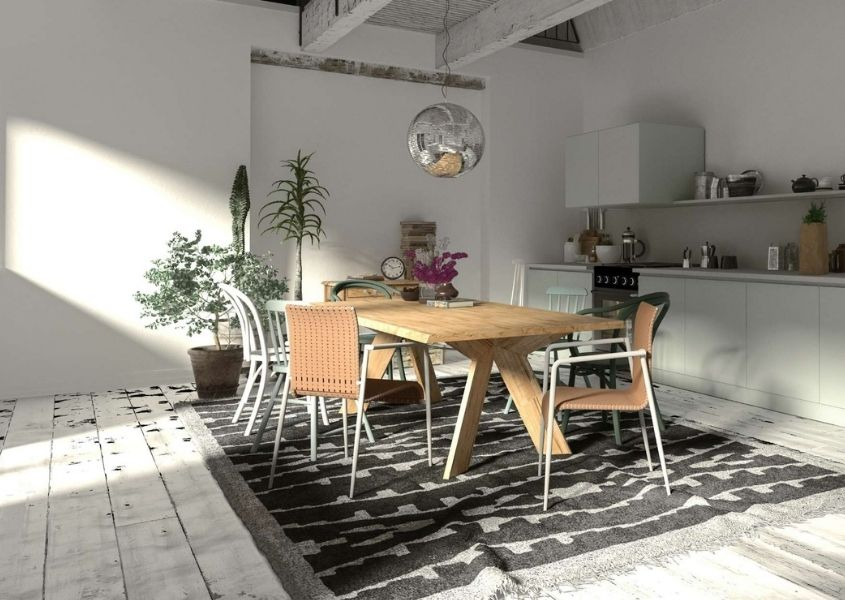Bright kitchen diner with wooden dining table, chairs and dark rug