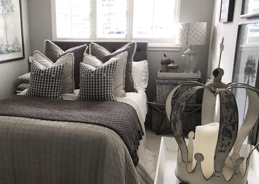 Double bed with grey covers and cushions