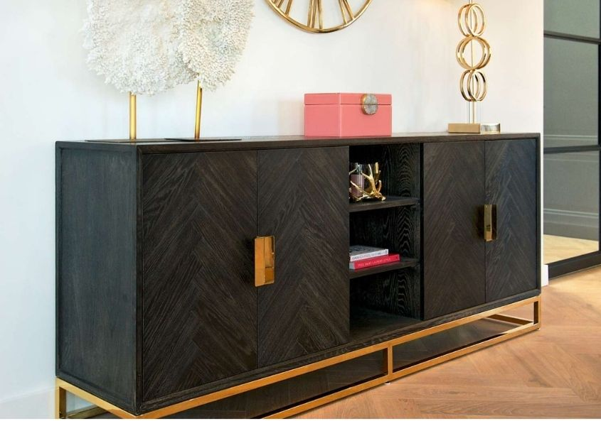 Dark wood sideboard with gold handle and frame
