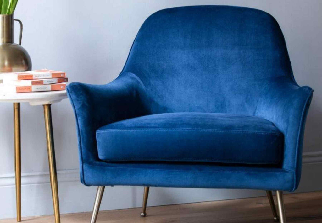 Bright blue velvet armchair with metal legs