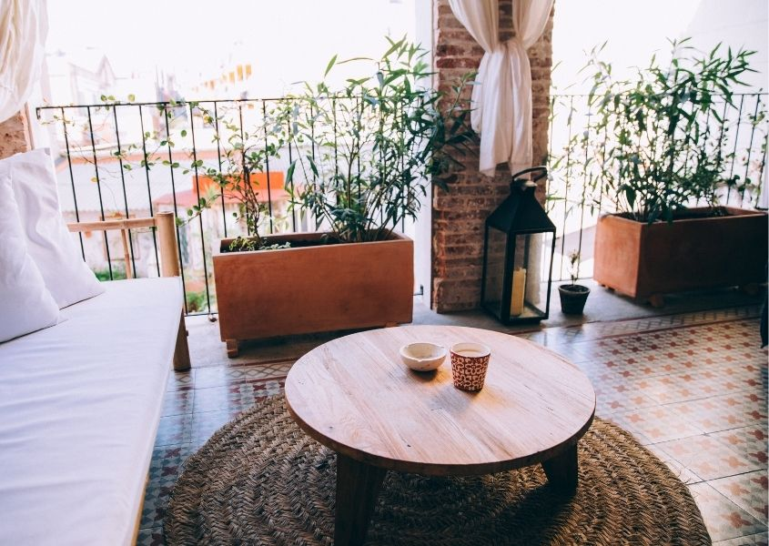 Wooden round coffee table on outdoor balcony