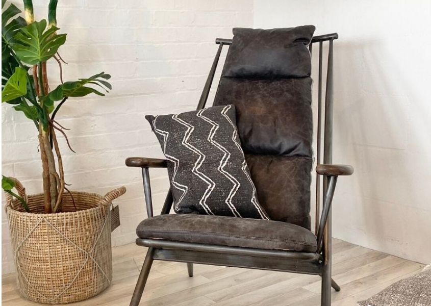 grey leather armchair with green house plant