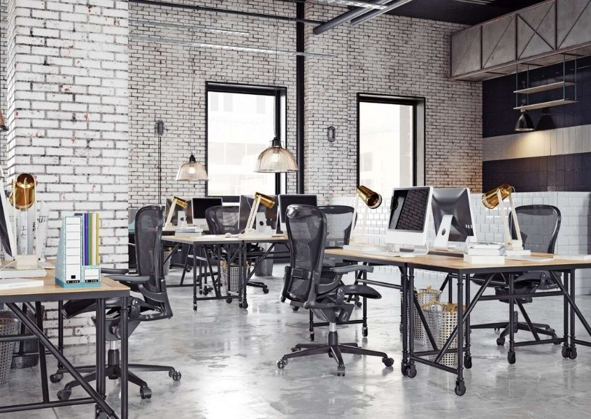 Industrial work space with industrial metal desks and high back office chairs