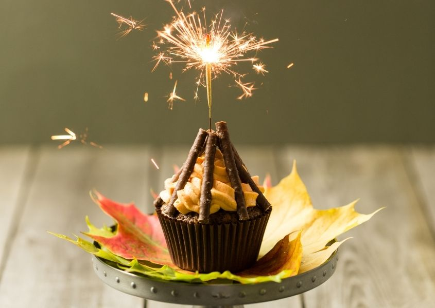 Bonfire night theme cupcake with sparkler in the top