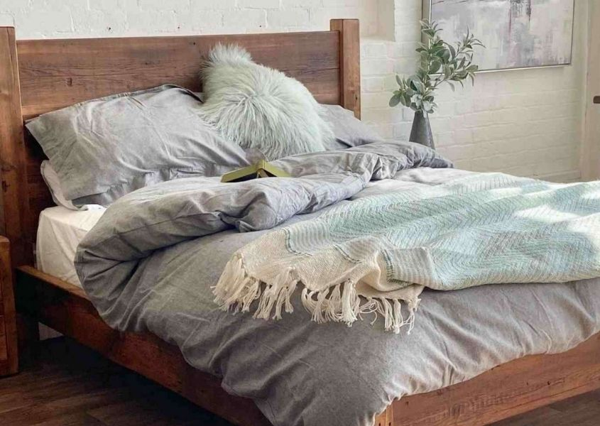 rustic wooden bed with grey covers