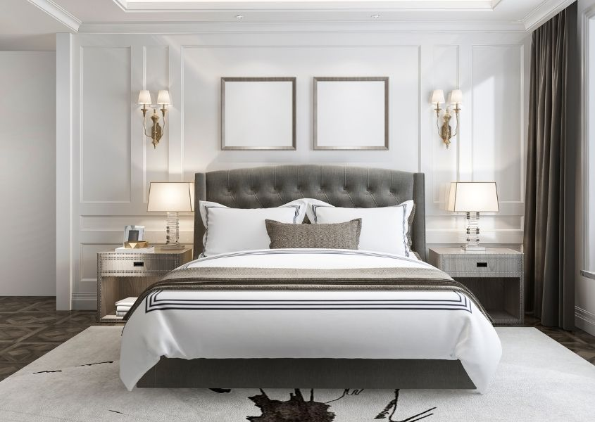 white hotel bedroom with grey king size bed frame