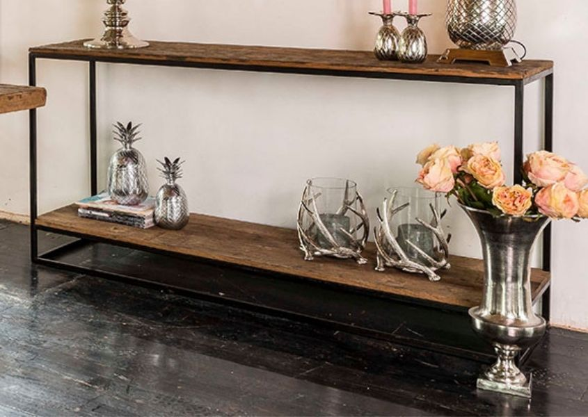 Industrial console table with silver flower vase