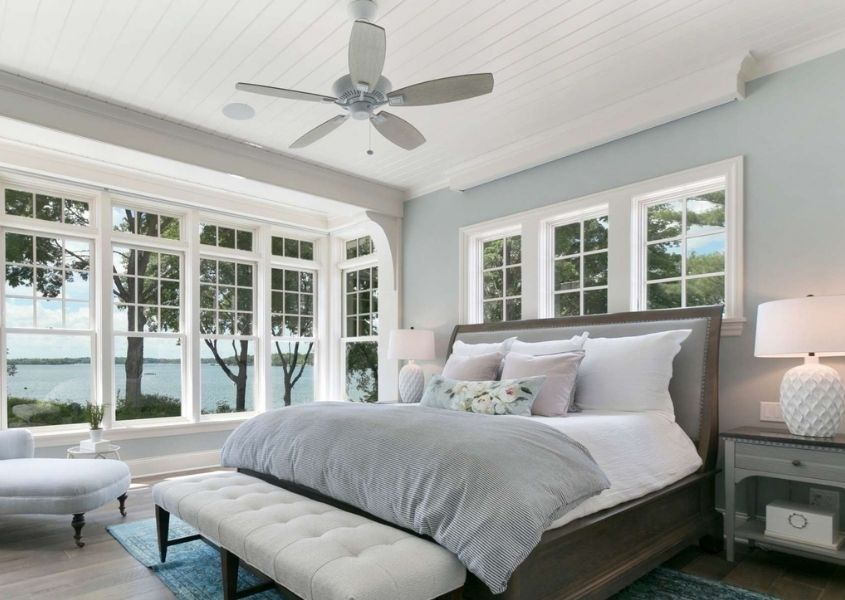 Wooden bed frame with white ceiling fan