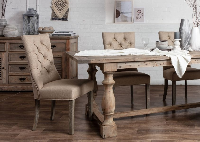 cream fabric dining chairs with reclaimed wood table