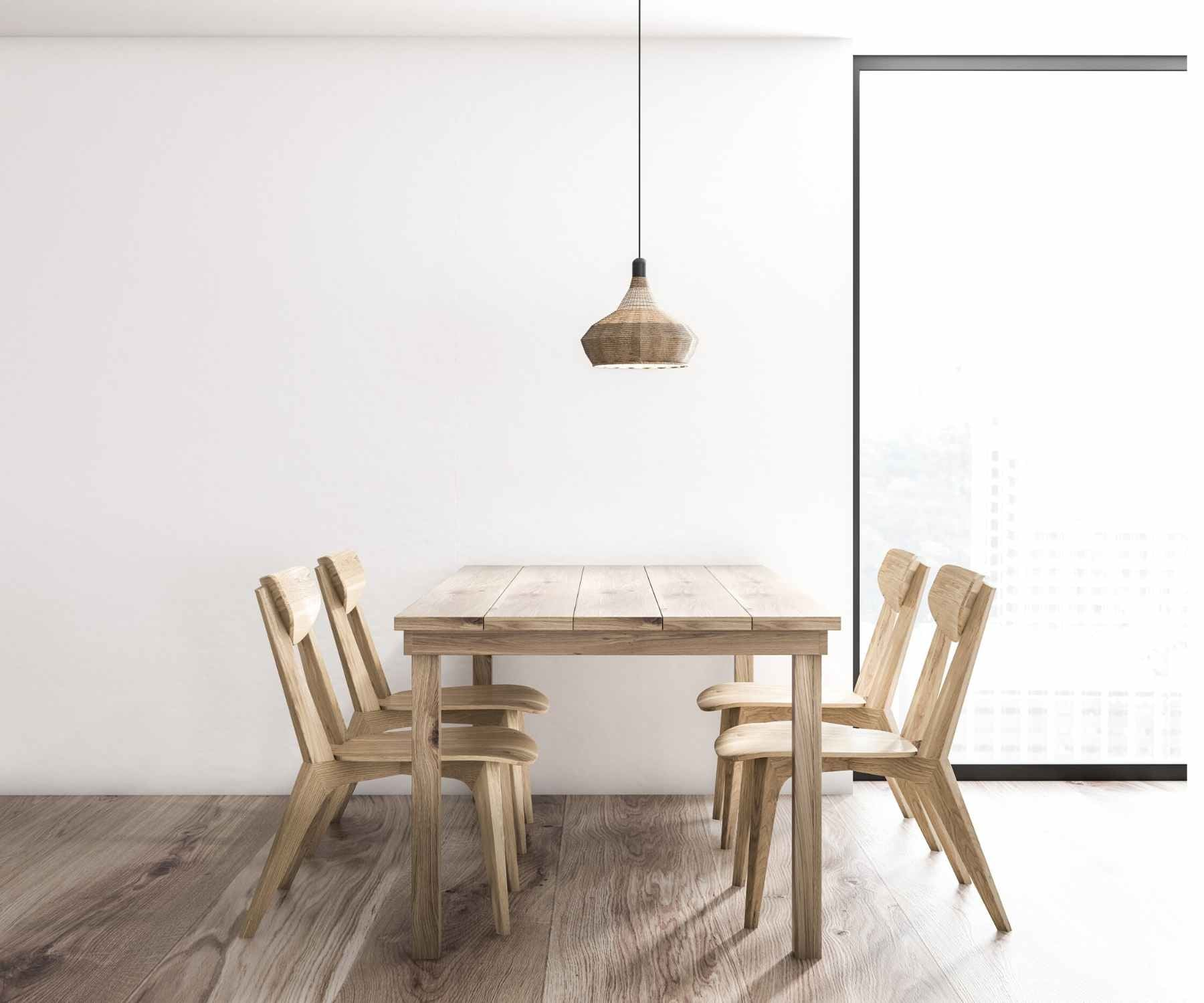 Wooden dining table and chairs in white minimalist room with pendant light