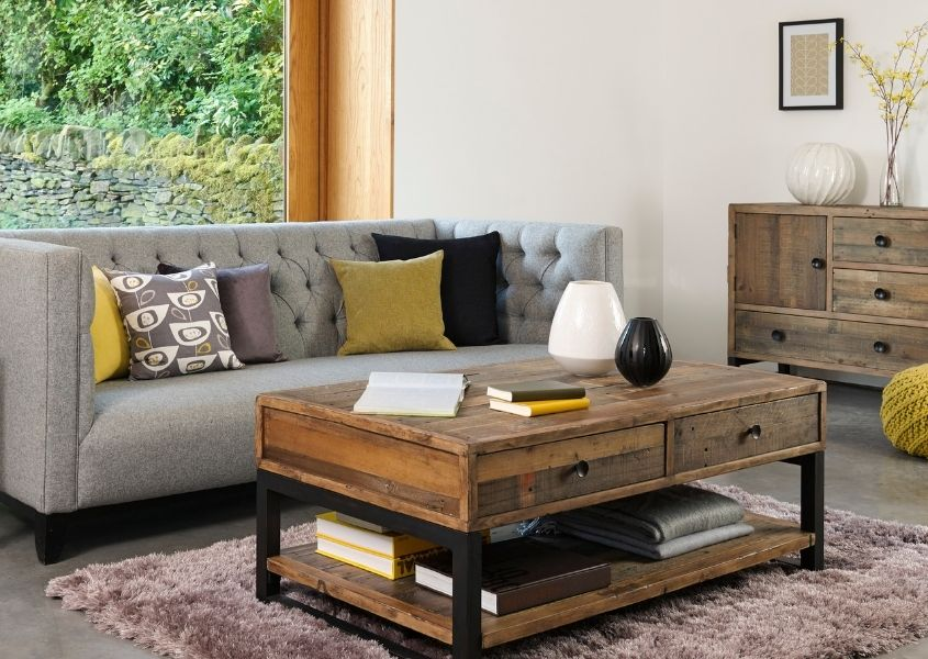industrial coffee table with modern grey sofa