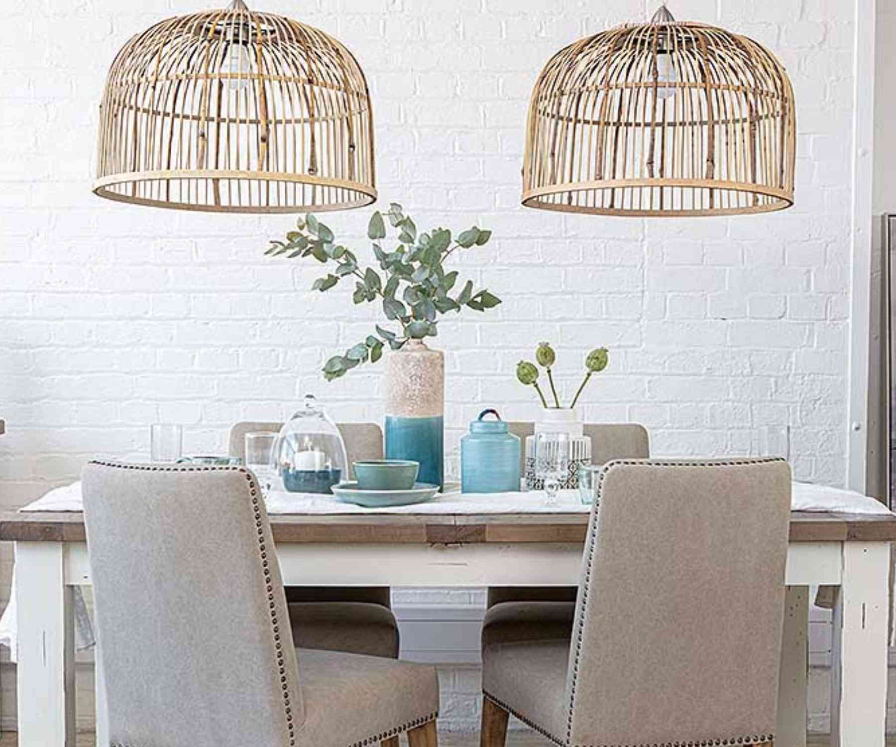White bamboo double pendant light over white wood dining table